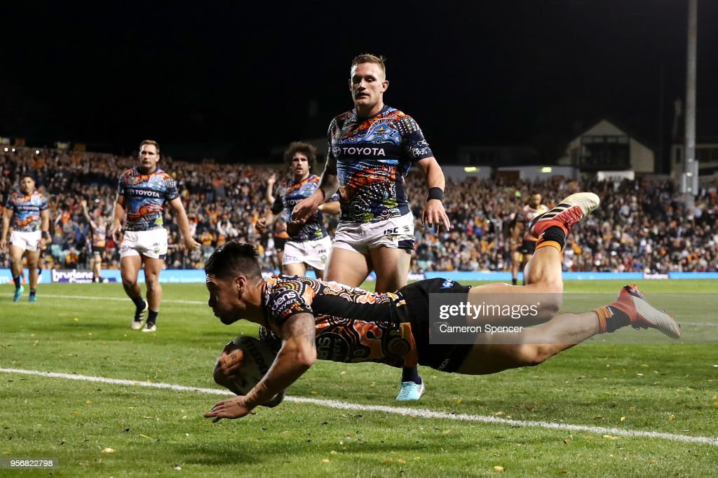Malakai Watene-Zelezniak of the Tigers scores a try during the round 10 NRL match between the Wests Tigers and the North Queensland Cowboys at Leichhardt Oval on May 10, 2018 in Sydney, Australia.