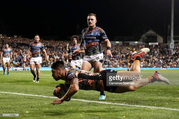 Malakai Watene-Zelezniak of the Tigers scores a try during the round 10 NRL match between the Wests Tigers and the North Queensland Cowboys at...