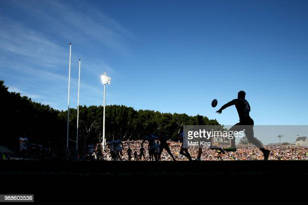 Malakai WateneZelezniak of the Tigers takes a pass during the round 16 NRL match between the Wests Tigers and the Gold Coast Titans at Leichhardt...
