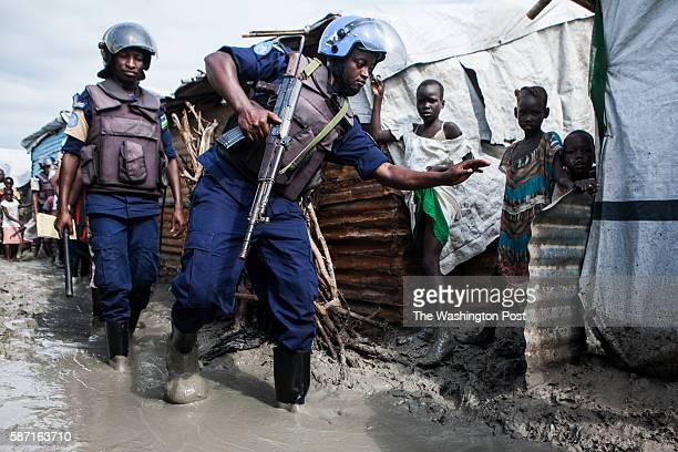 Malakal, South Sudan- Members of the United Nations Police, UNPOL, navigate the mud during a routine search of contraband in the Protection of...