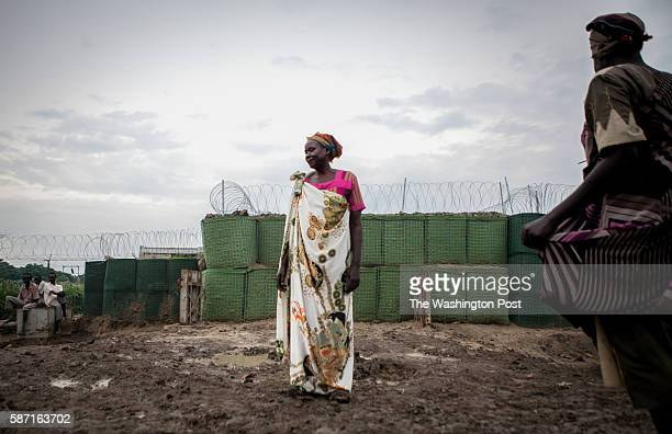 Malakal, South Sudan- Rachael Mayik stands outside a now barricaded Charlie Gate in the Protection of Civilians site at the United Nations Mission in...