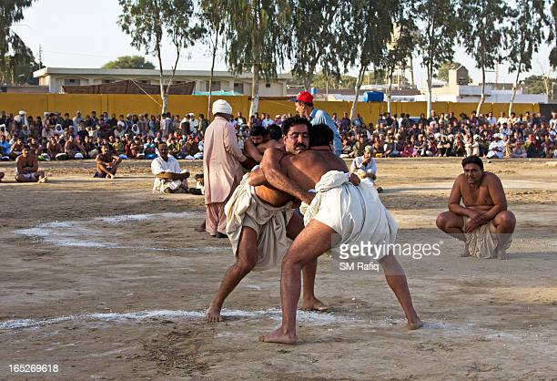 CONTENT] Malakhra is a traditional wrestling style of Sindh and the competition on go here is at the event of Urs celebration of Shah Abdul Lateef...