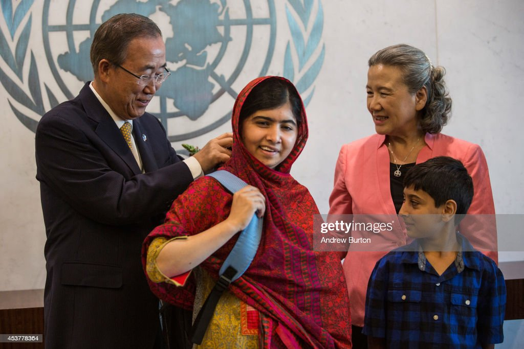 Malala Yousafzai, an education and women's rights activist (C), is given the gift of a backpack from United Nations (UN) Secretary General Ban Ki-Moon (L) on August 18, 2014 in New York City. Mala also attended a conference marking the UN's Millenium Development Goals.