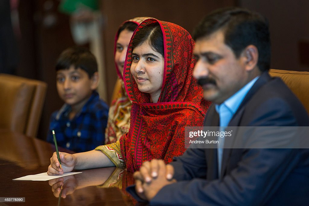 Malala Yousafzai (C), an education and women's rights activist, meets with United Nations (UN) Secretary General Ban Ki-Moon (not seen) on August 18, 2014 in New York City. Mala also attended a conference marking the UN's Millenium Development Goals.