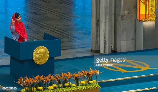 Malala Yousafzai delivers her acceptance speech to the audience during the Nobel Peace Prize ceremony at Oslo City Town Hall on December 10 2014 in...