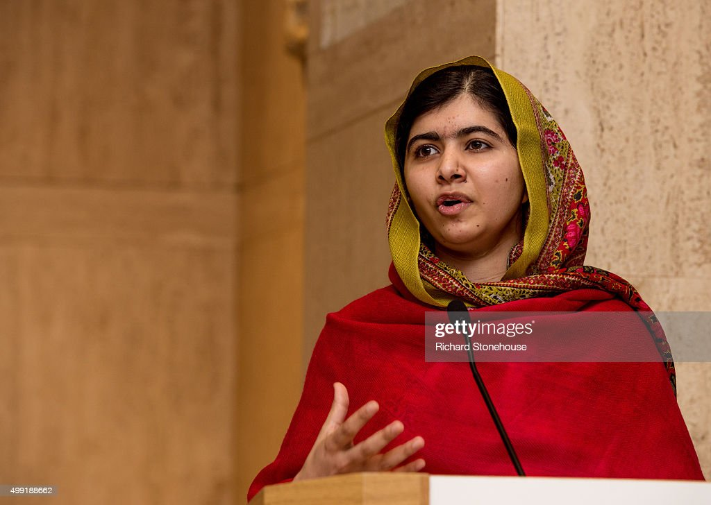 Malala Yousafzai gives a speech as she unveils her official portrait by artist Nasser Azam at Barbar Institute Of Fine Art on November 29, 2015 in Birmingham, England.