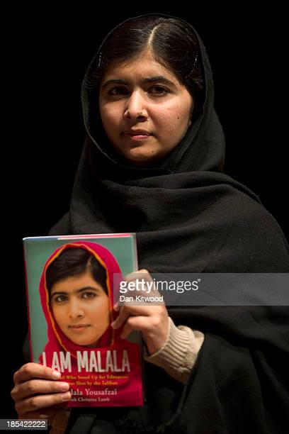 Malala Yousafzai holds her memoir, 'I Am Malala' during a photocall at the South Bank centre on October 20, 2013 in London, England. The 16-year-old...