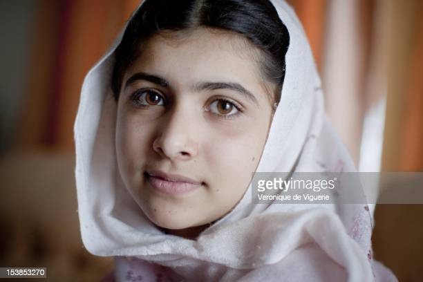 Malala Yousafzai lives in the Swat Valley with her family pictured on March 26 2009 in Peshawar Pakistan She wants to become a politician and is...