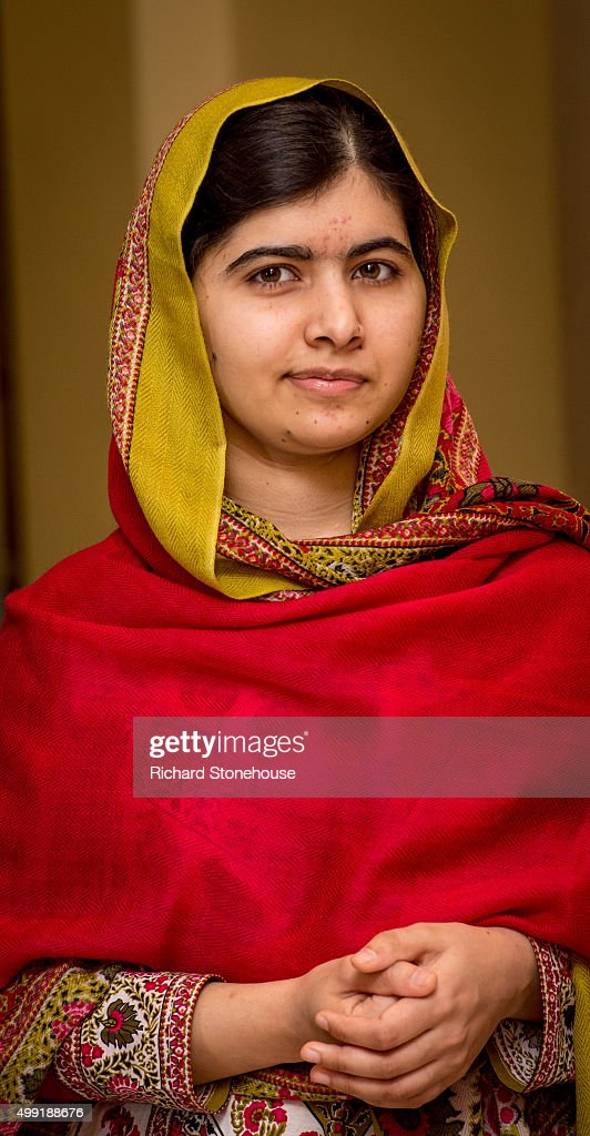 Malala Yousafzai prepares to unveil her official portrait by artist Nasser Azam at Barbar Institute Of Fine Art on November 29, 2015 in Birmingham, England.