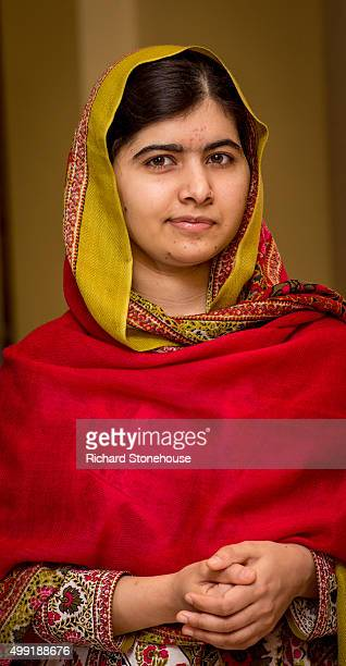 Malala Yousafzai prepares to unveil her official portrait by artist Nasser Azam at Barbar Institute Of Fine Art on November 29, 2015 in Birmingham,...
