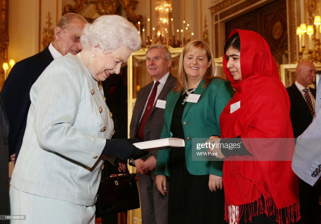 Queen Elizabeth II Receives Malala At Buckingham Palace : News Photo
