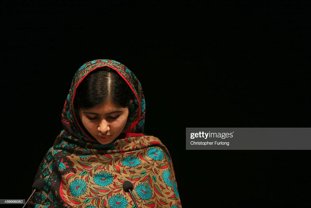 Malala Yousafzai speaks during a press conference at the Library of Birmingham after being announced as a recipient of the Nobel Peace Prize, on October 10, 2014 in Birmingham, England. The 17-year-old Pakistani campaigner, who lives in Britain where she received medical treatment following an assassination attempt by the Taliban in 2012, was jointly awarded the Nobel peace prize with Kailash Satyarthi from India. Chair of the Nobel Committee Thorbjorn Jagland made the announcement in Oslo, commending Malala for her 'heroic struggle' as a spokesperson for girls' rights to education.