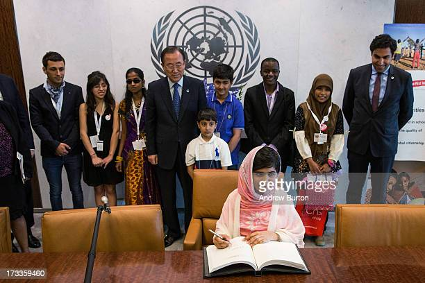 Malala Yousafzai the 16yearold Pakistani advocate for girls education who was shot in the head by the Taliban signs the United Nations guest book...