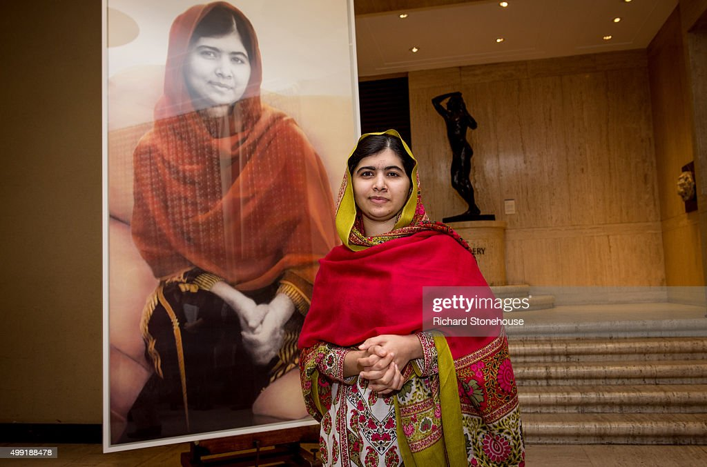 Malala Yousafzai unveils her official portrait by artist Nasser Azam at Barbar Institute Of Fine Art on November 29, 2015 in Birmingham, England.