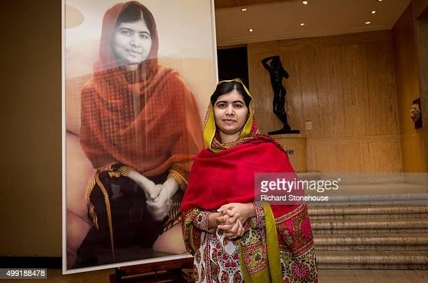 Malala Yousafzai unveils her official portrait by artist Nasser Azam at Barbar Institute Of Fine Art on November 29, 2015 in Birmingham, England.