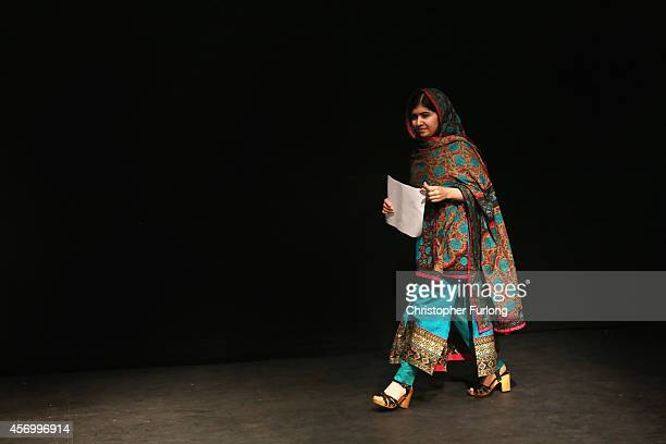 Malala Yousafzai walks onstage during a press conference at the Library of Birmingham after being announced as a recipient of the Nobel Peace Prize...