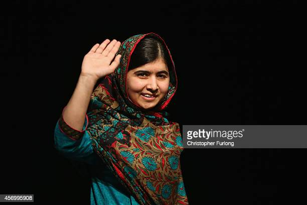 Malala Yousafzai waves to the crowd at a press conference at the Library of Birmingham after being announced as a recipient of the Nobel Peace Prize,...