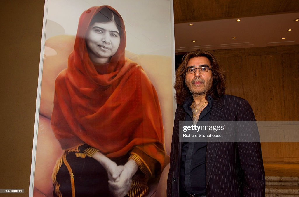 Malala Yousafzai's official portrait is unveiled by artist Nasser Azam at Barbar Institute Of Fine Art on November 29, 2015 in Birmingham, England.