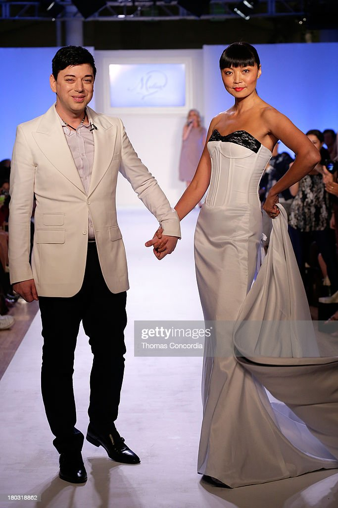 Malan Breton and Irina Pantaeva walk the runway at Malan By Malan Breton Sponsored by Fancy Feast Gourmet Cat Food at the STYLE360 Fashion Pavilion in Chelsea on September 11, 2013 in New York City.