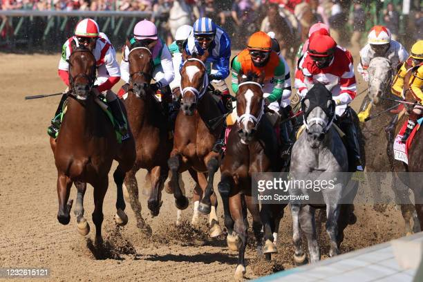 Malathaat ridden by jockey John Velazquez is in the middle in the blue and white silks as the field comes down the front stretch and ends up...