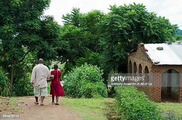 Malawi Blantyre The 11 year old defilement victim poses with her father in front of their house This young girl is in Standard 6 and her father Lloyd...