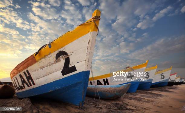 malawi, colorful fishing boats - dietmar temps stock photos and pictures