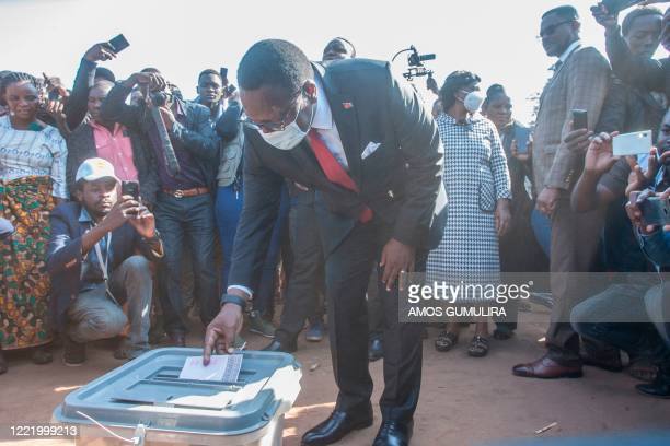 Malawi Congress Party president Lazarus Chakwera casts his ballot during the presidential elections at the Malembo polling station in his home...
