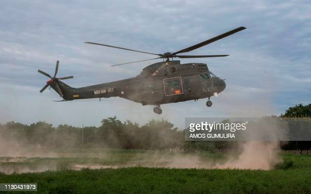 A Malawi Defence Force helicopter takes off on March 14 from Bangula camp for people displaced by floods after delivering relief items to areas...