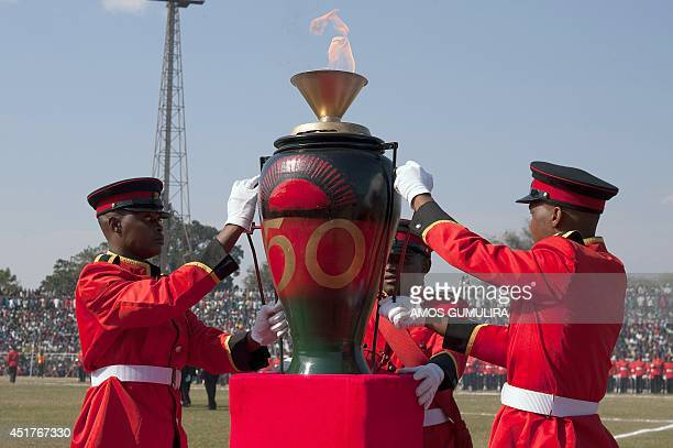 Malawi Defence Force soldiers set up the burning anniversary candle during celebrations for the Malawian 50th independence anniversary at Civo...