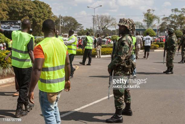 Malawi Defence Force soldiers stand guard as they close-off the premises around the Malawian parliament to prevent access by Malawi opposition...