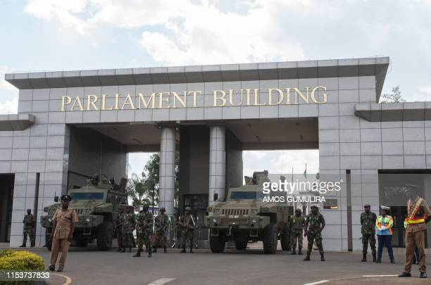 Malawi Defence Force soldiers stand guard with armoured vehicles at the entrance of the Malawian parliament during a demonstration by Malawi...