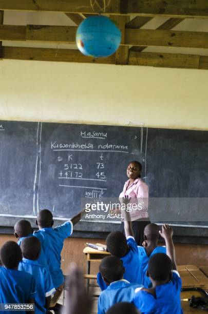 Malawi Lilongwe Chambwe Primary School Pupils in the classroom about 40 kilometres west of Lilongwe learning comfortably on desks Through UNICEFS...