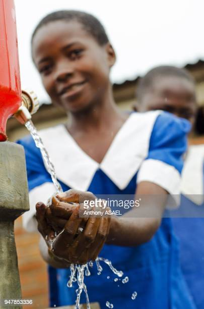 Malawi Lilongwe Chambwe Primary School pupils washing hands after using the sanitary facilities built by the Unicef