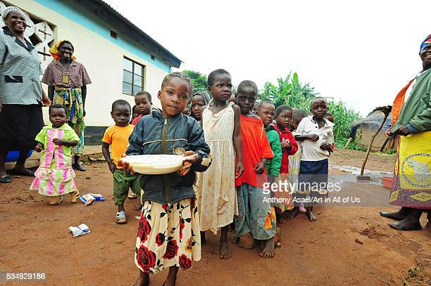 Malawi Mzimba district Chilumba Chilumba Community Based Childcare Centres children get plates of porridge and eat their lunch The CBCC is home to...