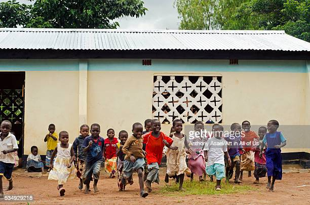 Malawi Mzimba district Chilumba Chilumba Community Based Childcare Centres children running in front of building