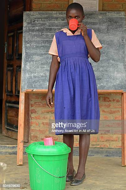 Malawi Mzimba district Thundwe Primary School 13 year old Standard 6 pupils at Thundwe Junior Primary School Salome Ndhlovu drinks water from a...