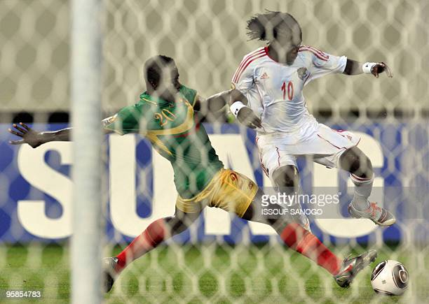 Malawi National football team player Josephy duels for the ball with Mali's Lassina Fane on January 18 2010 at the Chiazi stadium in Cabinda during...