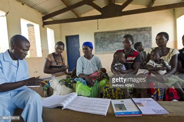 Malawi Northern Region Rumphi Health Surveillance Assistant Bruno Banda checks the condition of children at Chozoli Village Clinic in Rumphi District