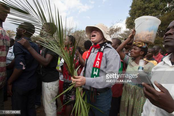 Malawi opposition supporters march to the Malawian parliament during a demonstration against the re-election of the president, which protestors say...