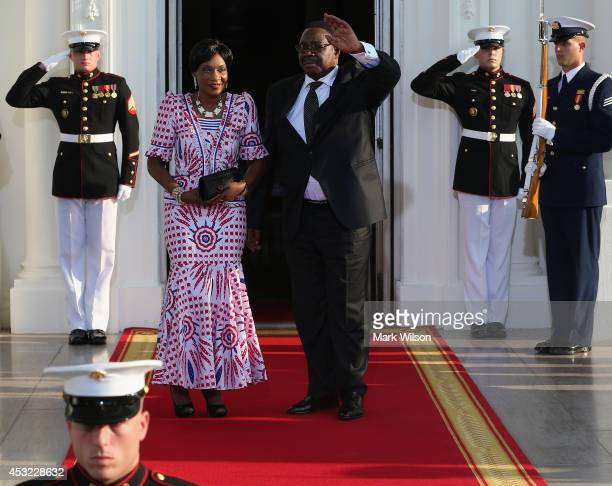 Malawi President Arthur Peter Mutharika and spouse Gertrude Hendrina Mutharika arrive at the North Portico of the White House for a State Dinner on...