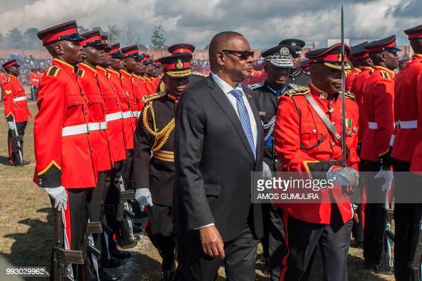 Malawi President Arthur Peter Mutharika inspects a military parade mounted by the Malawi Defence Force during national celebrations at Mzuzu Stadium...