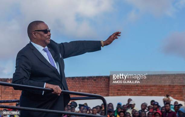 Malawi President Arthur Peter Mutharika waves to the crowd as he arrives to the national celebrations at Mzuzu Stadium to commemorate the country's...