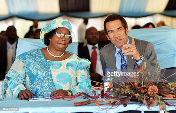 Malawi president Joyce Banda speaks with Botswana president Ian Khama during the official opening of a Poverty Eradication workshop in Maun...