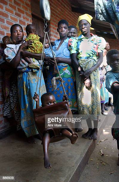 Malawian baby is weighed at the Nutritional Rehabilitation Unit July 1 2002 in the Chikwawa District Hospital located about 50 kilometers south of...