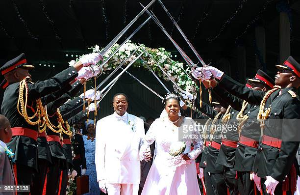 Malawian President Bingu wa Mutharika and his Bride Callista walk under a millitary sword salut by officers of the Malawian defence forces after...