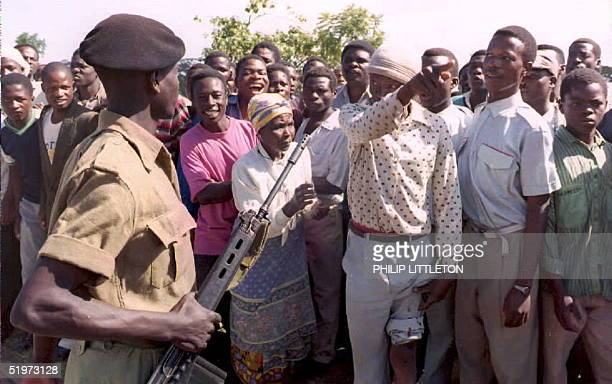 Malawian soldier keeps the crowd at bay amongst them a man bitten by a police dog 24 April as Blantyre's High Court was told that ageing expresident...