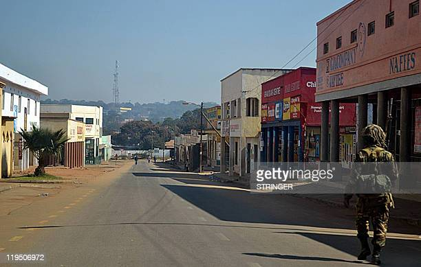 A Malawian soldier patrols the deserted streets of Lilongwe on July 21 a day after mass protests against Malawi's President Bingu wa Mutharika...