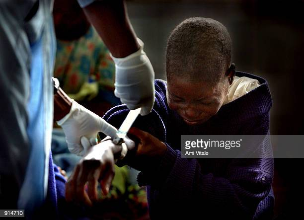 Malawian woman suffering from the HIV virus is treated at the Queen Elizabeth Hospital July 4 2002 in Blantyre Malawi In Malawi and several other...