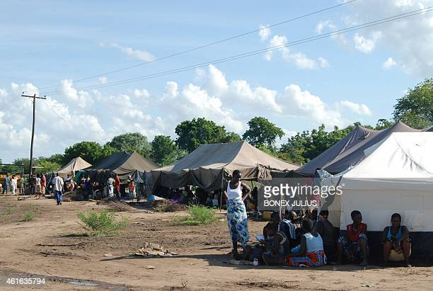 Malawians displaced by the torrential rains and floods of the last few days take shelter in tents in the Milima area of Chikhwawa Malawi on January...