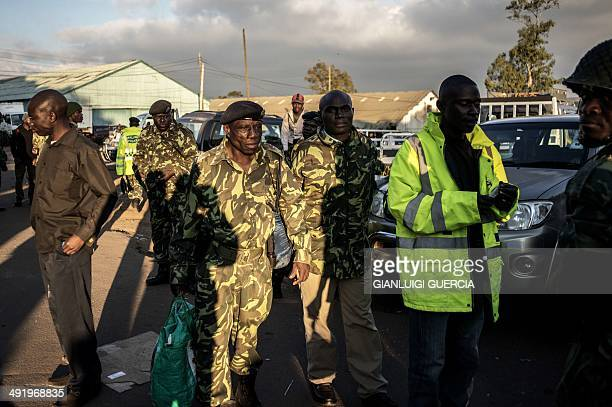 Malawi's police force get ready to be dispatched in each polling station around the country at the Malawi's Electoral commission headquarter on May...